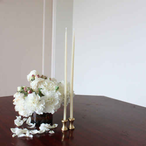 brass candleholder with pure beeswax taper dinner candles