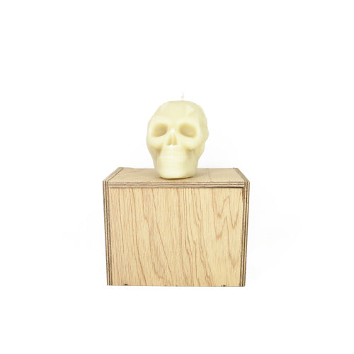 Pure beeswax Skull Candle from Queen B on Australian made wooden coffin