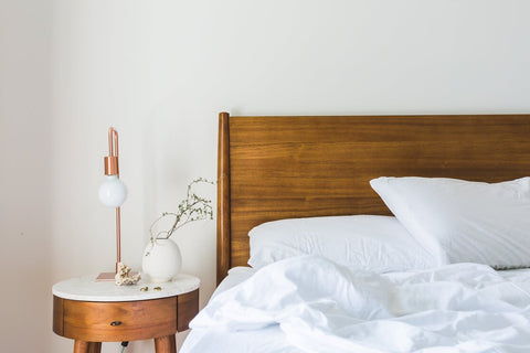 Wood bed with with sheets