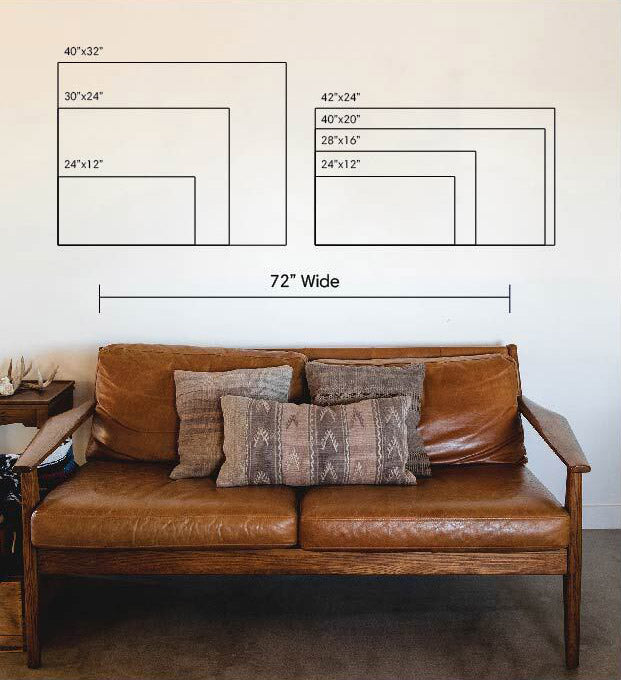 a room with a wall diagram of differently sized art frames