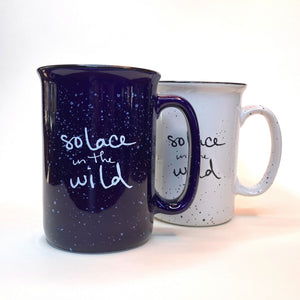 Solace in the Wild ceramic mugs in blue and white with retro speckle campfire style