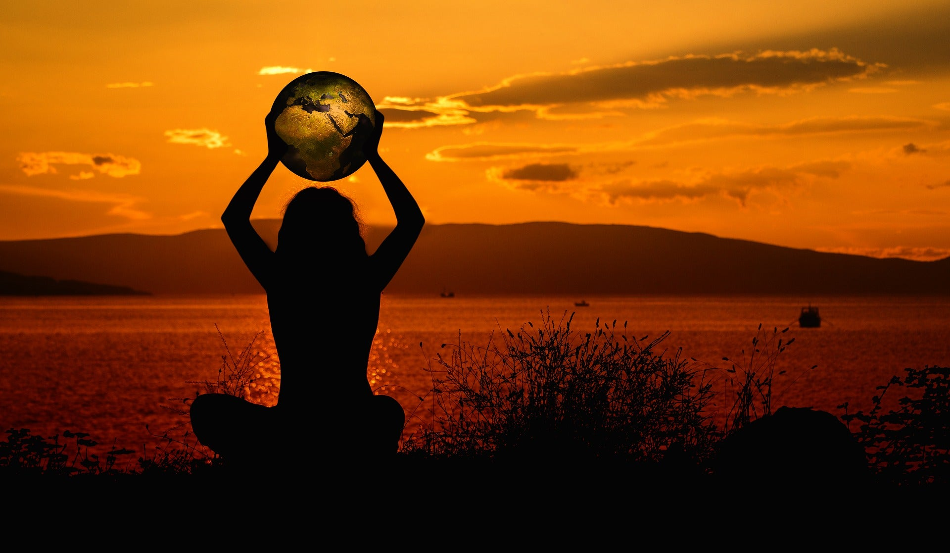 Sustainability Pledge image | One Wear Freedom | Sunset silhouette of woman holding the world or globe | saving mother earth
