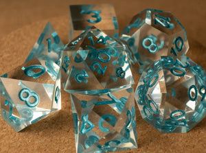 Crystal clear dice set w/metallic light teal ink