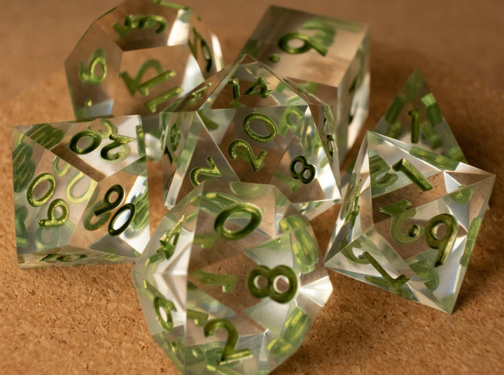 Crystal clear dice set w/metallic green ink