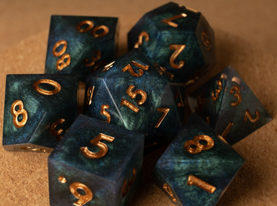 Deep ocean (blue & green) swirl effect dice set w/antique brass ink