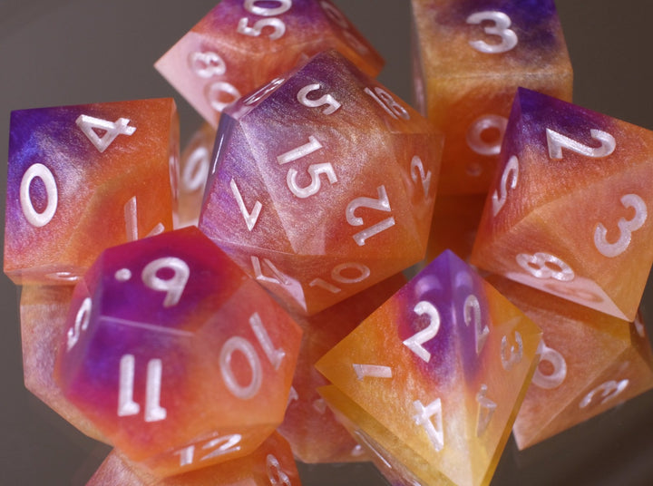 Layered Sunset (purple, pink, orange, yellow) dice set w/golden pearl ink