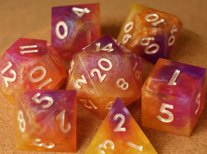 Sunset Swirl (yellow, orange, pink & purple) dice set w/golden pearl ink