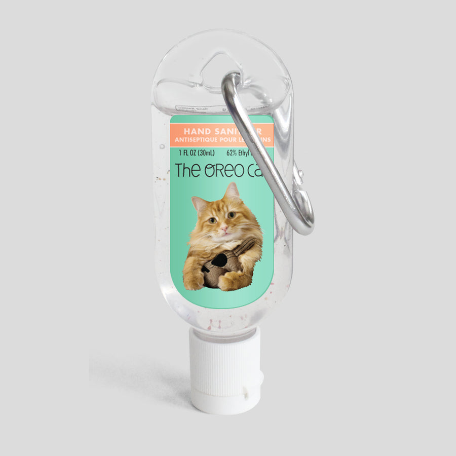 The Oreo Cat Clip-It Refillable Hand Sanitizer (Pudding)