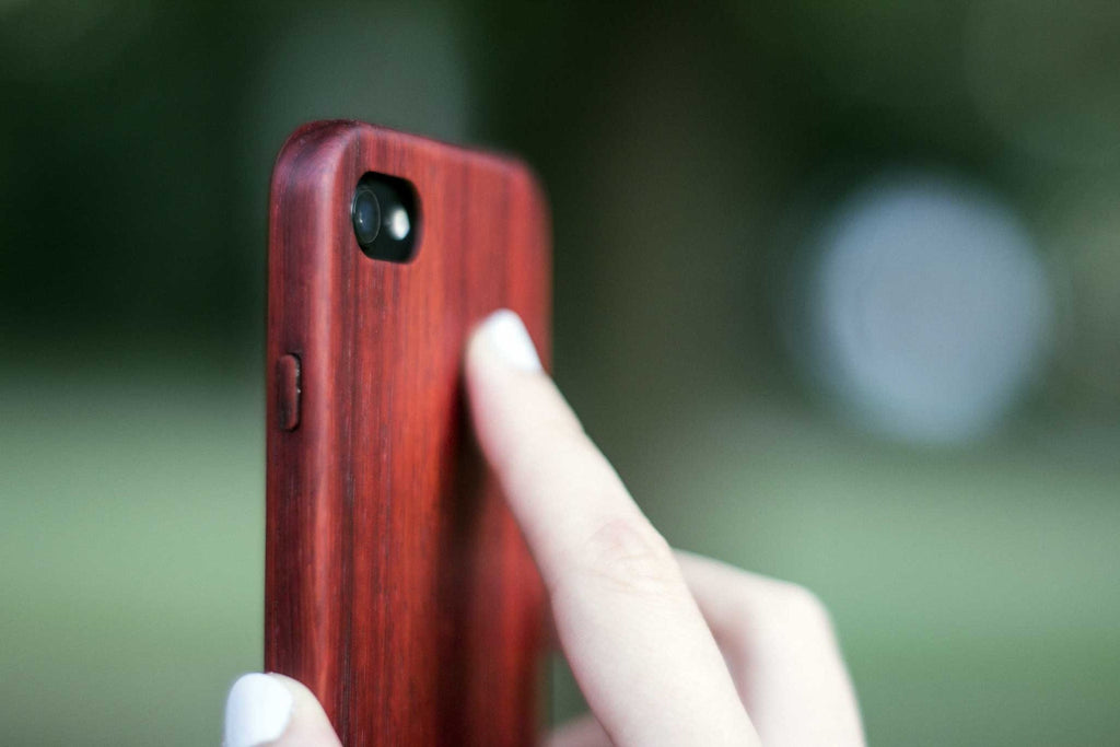 wood iPhone 7 Case - padauk - side view outside - lifestyle