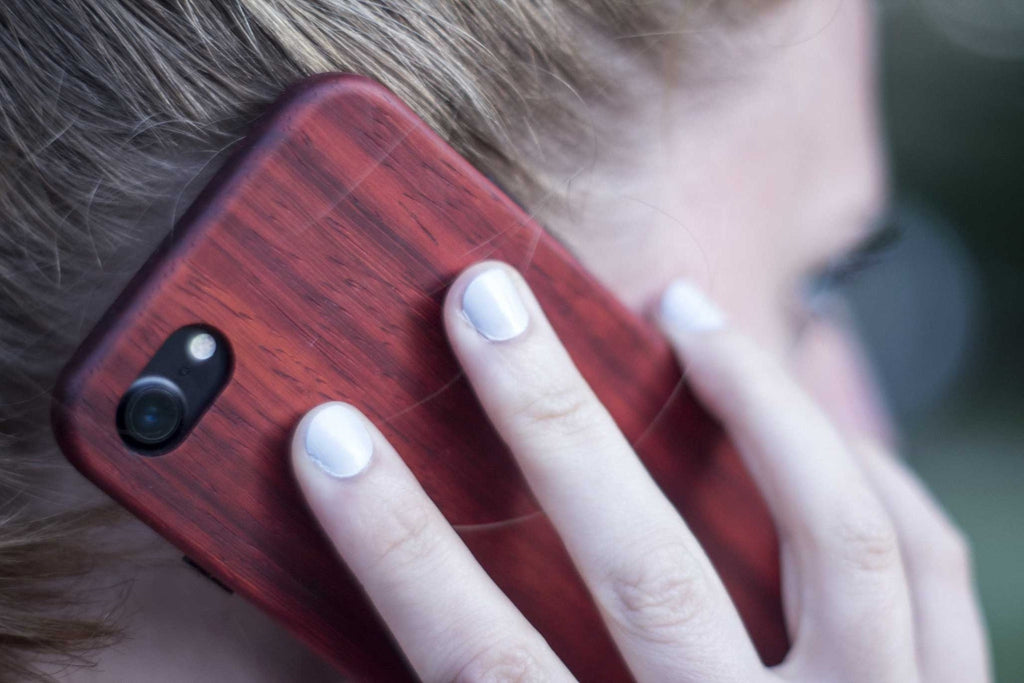wood iPhone 7 Case - padauk - talking view - lifestyle