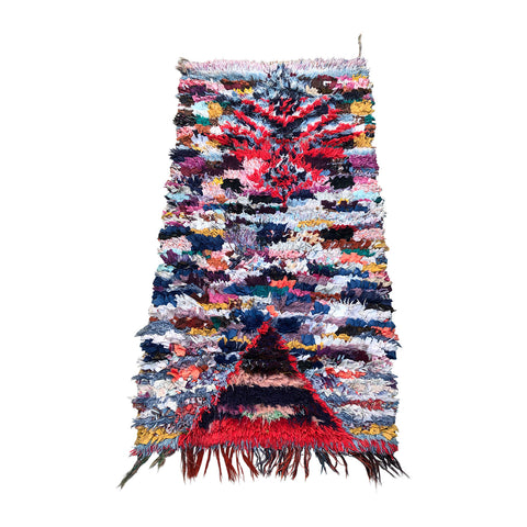 Moroccan boucherouite rag rug made with colorful tufted cotton in traditional Berber rug style