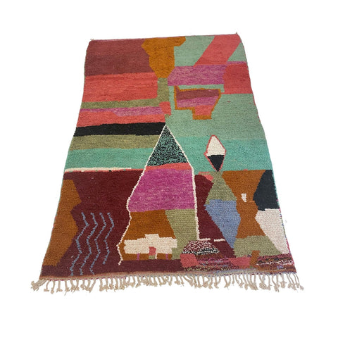 Hand-knotted pile Moroccan rug from Kantara's LA showroom featuring the best of Berber rugs with bohemian design and bold design
