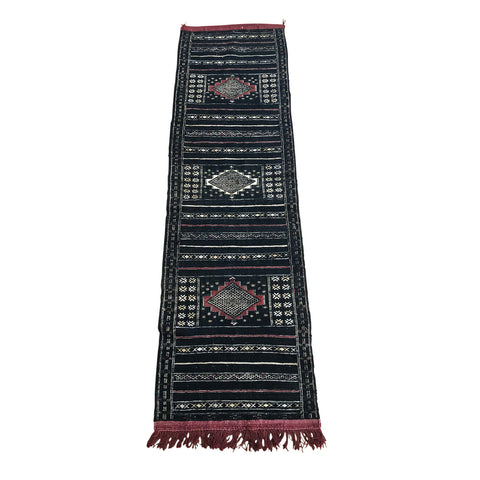 Black Moroccan runner rug with maroon tassels