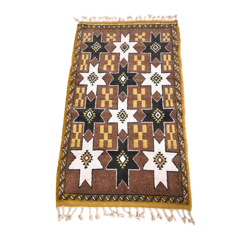 Brown Moroccan rug with tribal motifs