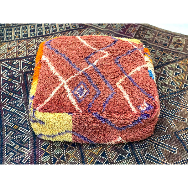 Boho chic red, orange, and white Moroccan floor pouf pillow - Kantara | Moroccan Rugs