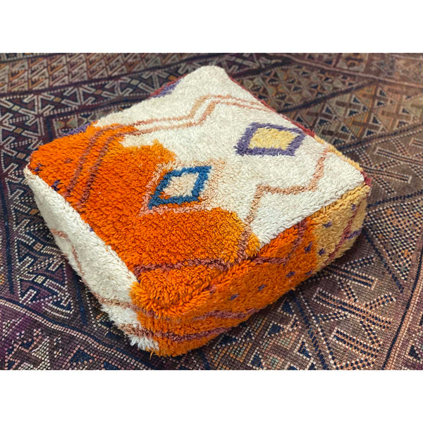 Colorful floor pouf made from upcycled orange and white Moroccan rug - Kantara | Moroccan Rugs