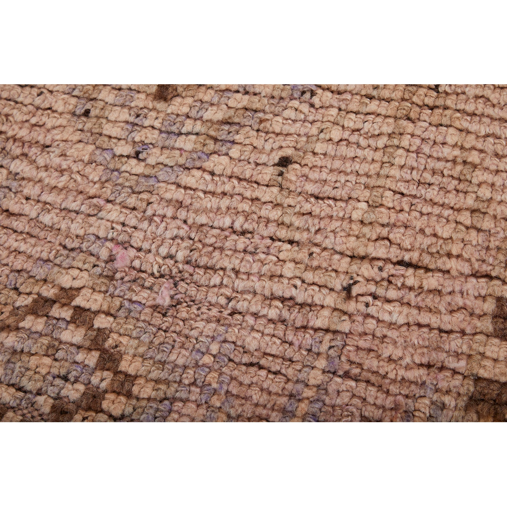 Detail of low-pile vintage Moroccan Berber rug with faded colors and classic design