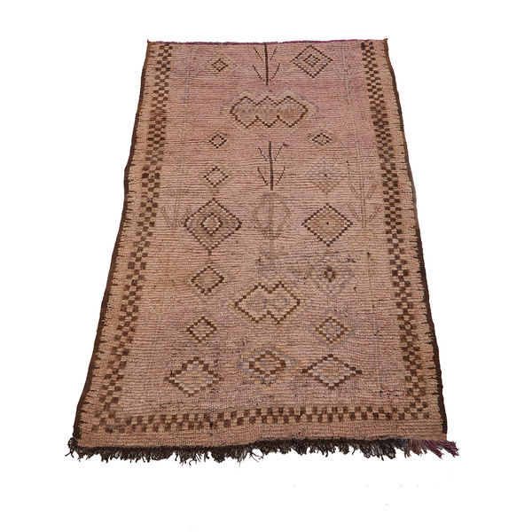 Checkerboard Moroccan rug in brown and neutral tones with diamond abstract designs