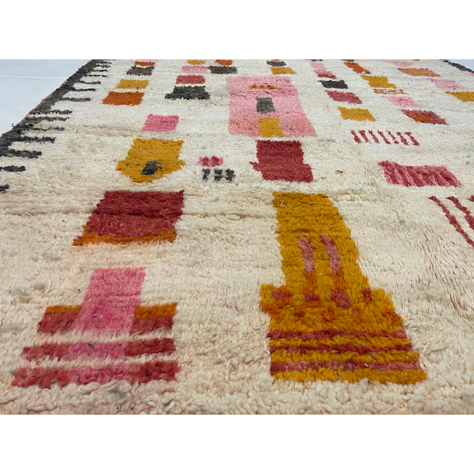 Detail of Modern Berber rug with pink and yellow designs