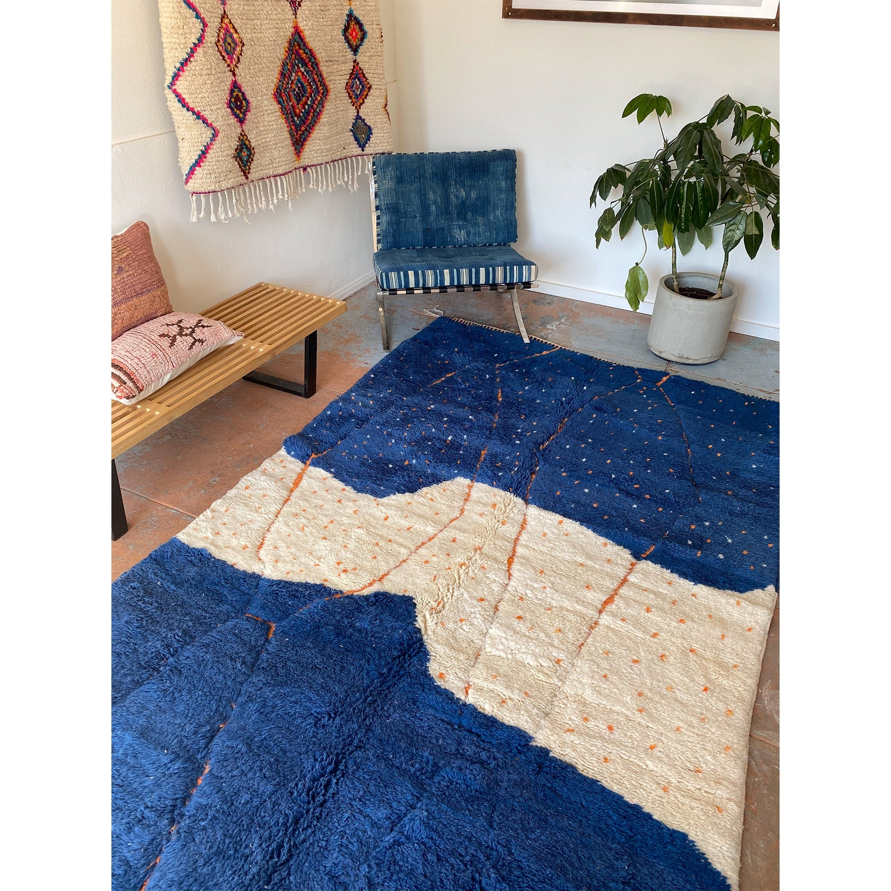 Contemporary blue and white Moroccan rug featured in a bohemian space - Kantara | Moroccan Rugs