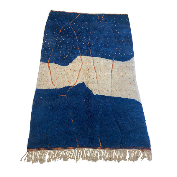 Blue and white Moroccan Moroccan area rug with orange details - Kantara | Moroccan Rugs