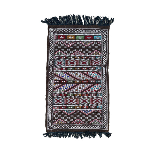 Brown Moroccan flatweave kilim throw rug with colorful details - Kantara | Moroccan Rugs