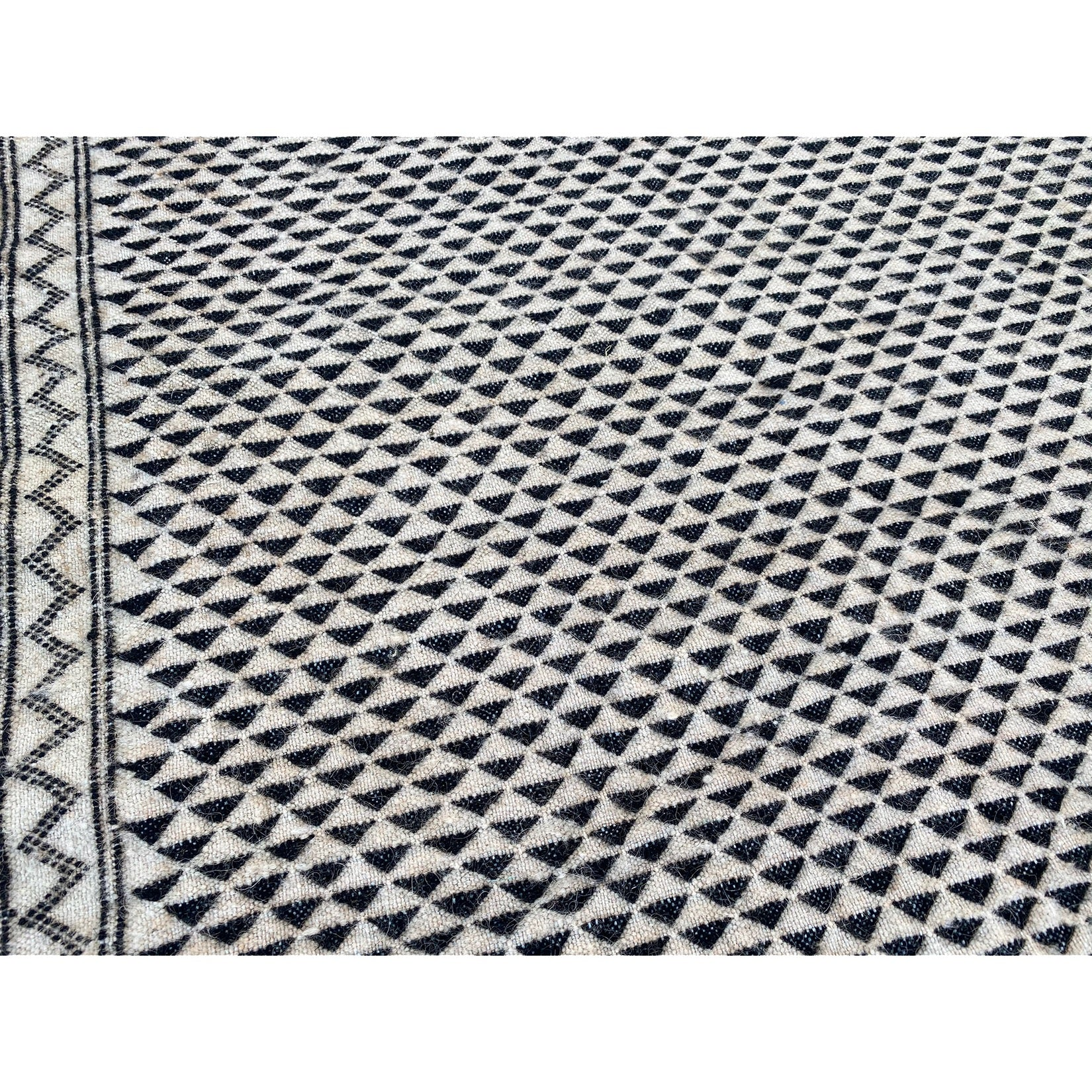 Mid century modern white Moroccan flatweave rug with black details - Kantara | Moroccan Rugs