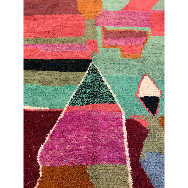 Large abstract Moroccan berber area rug with details in green, pink, and orange - Kantara | Moroccan Rugs