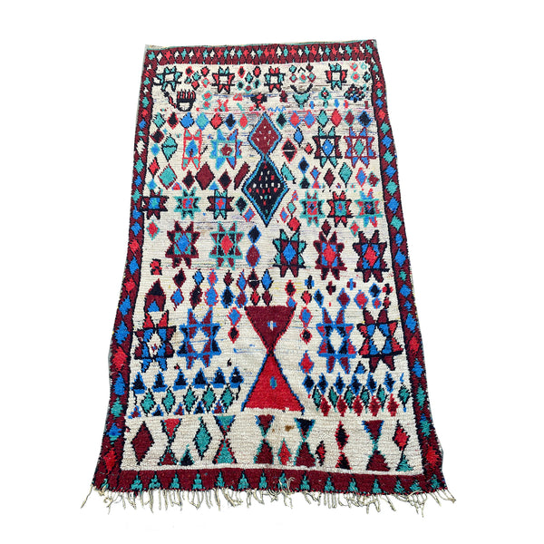 White Moroccan entryway rug with blue and red tribal motifs - Kantara | Moroccan Rugs