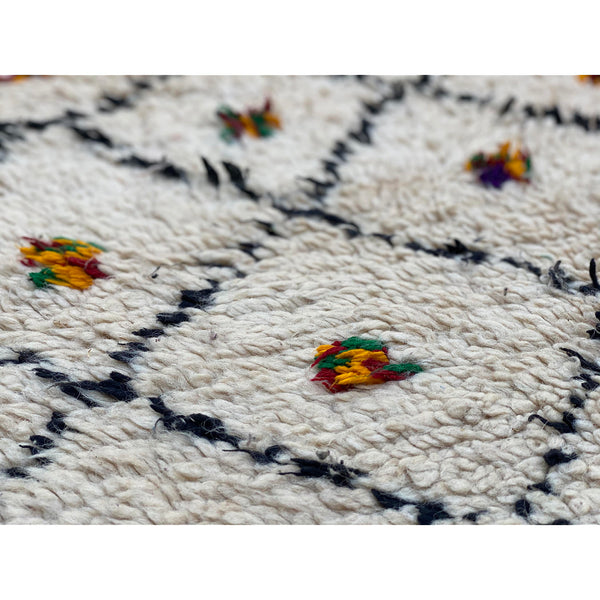 Black and white Moroccan diamond rug with colorful cotton accents - Kantara | Moroccan Rugs