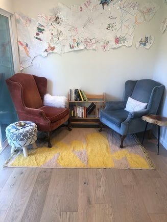 Contemporary living room featuring a yellow Moroccan throw rug