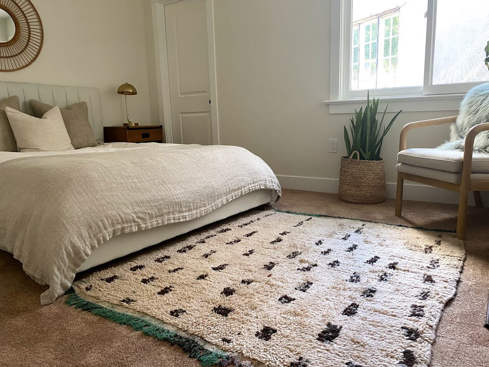 Neutral Moroccan rug in a boho chic bedroom
