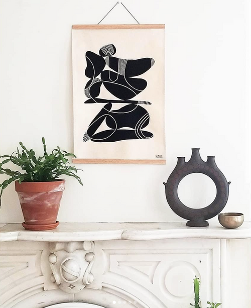 Limited Edition canvas art from Claudia Pearson's Ebb + Flow collection above mantel