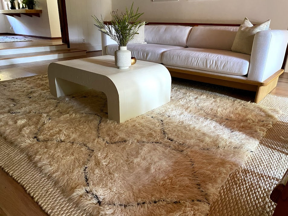Minimalist boho chic living room featuring a plush white Beni Ourain Moroccan rug