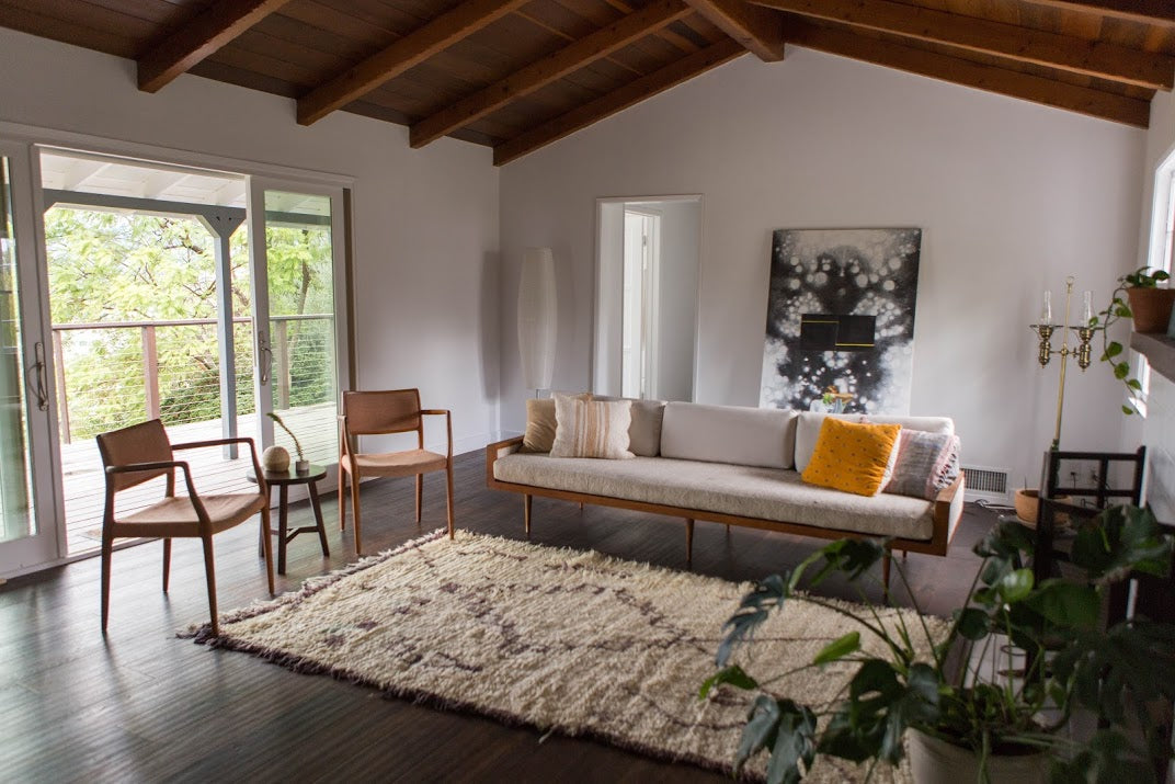 Cream colored Moroccan rug in modern interior living room