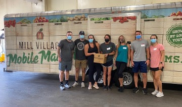 Jack and other LifeMade employees volunteering at Mill Village Farms