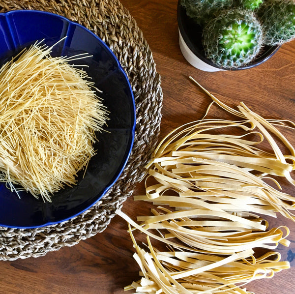 Thin and wide noodle or pasta (Romanian lasca) in table setting - De Mana