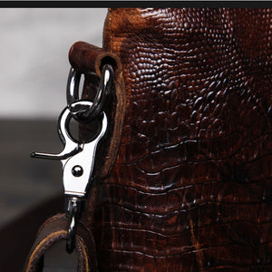 Wow factor Genuine Leather crocodile look marbled coffee coloured and dark tan mens messenger bag here is how the the strap buckle attaches to the bag