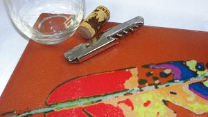 Cutting Board, Glass; Feather on Burnt Siena Background