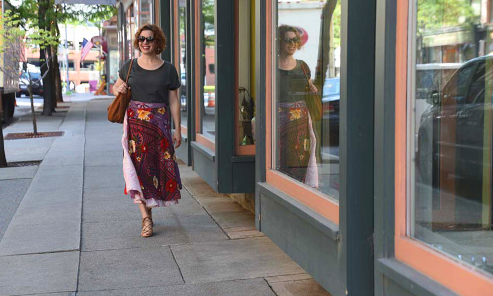 Nicole Snow, Founder of Good Sol wearing a sari wrap skirt while walking in Troy, New York