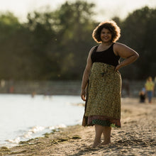 Load image into Gallery viewer, woman wearing a yellow and brown skirt on a beach