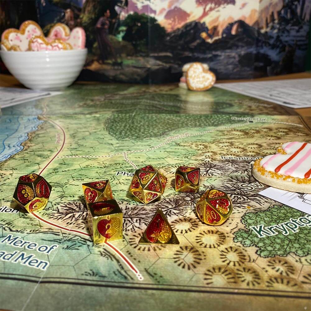 Picture of DnD game set up with metal dice on a map