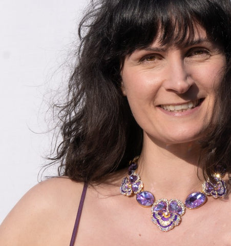Nicola wears Butler & Wilson Crystal Pansy Necklace