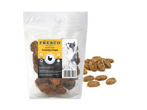 A bag of Fresco chicken training drops for dogs. Example drops are next to the bag.