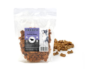 A bag of Fresco beef-flavoured training treats for dogs. Example treats are beside the bag.