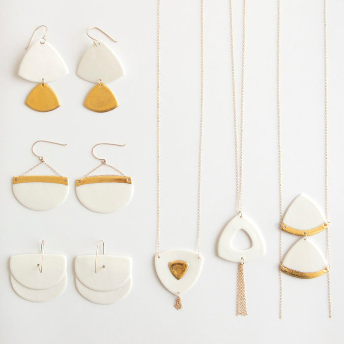porcelain jewellery collection, white necklaces and earrings decorated with fine gold