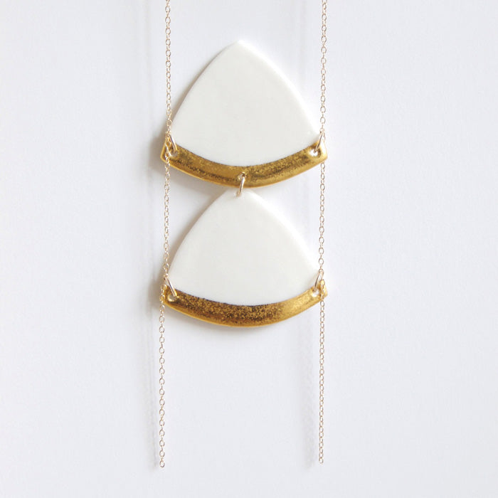 diamond triangle porcelain necklace decorated with fine gold