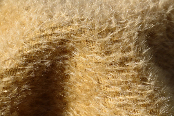 Biscuit 9 mm quite sparse, straight pile, mohair for teddy bears with a soft faded gold pile and backing by Make A Teddy