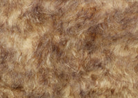 Chocolate Chip Truffle 25 mm (one inch) chestnut brown tipped beige dense, distressed mohair for teddy bears with a beige backing Chocolate Chip Truffle is a gorgeous chestnut brown-tipped beige mohair with a soft and fluffy 1 inch pile. It's a great colour and texture for medium and large teddy bears. The backcloth is also beige meaning that if you trim the snout of your bear it will have a pale beige snout and an interesting mottled brown and cream colouring.