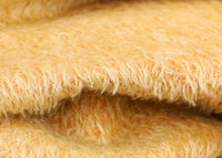 Golden Cracker 12 mm quite sparse, distressed (ratinee) mohair for teddy bears with a golden pile and warm beige backing This has a moderately short, distressed, fairy sparse, golden pile and a warm beige backing, which helps make your bear's face stand out.  It's a great colour for smaller traditional teddy bears, or larger bears that you want to look old and loved.